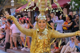 Aladdin's coin dancer proclaims the arrival of Prince Ali in Mickey's Soundsational Parade.