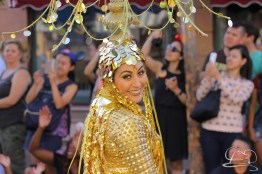 A smile from the coin dancer in the Aladdin unit of Mickey's Soundsational Parade.
