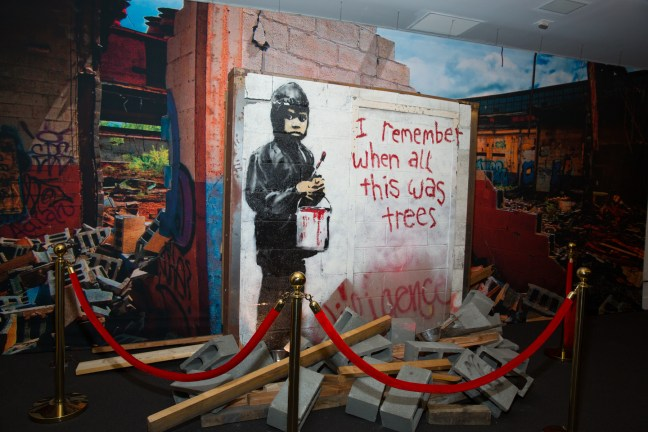 """Banksy's """"I remember when all this was trees"""" at Julien's Auctions - Photo: Jack Burke"""