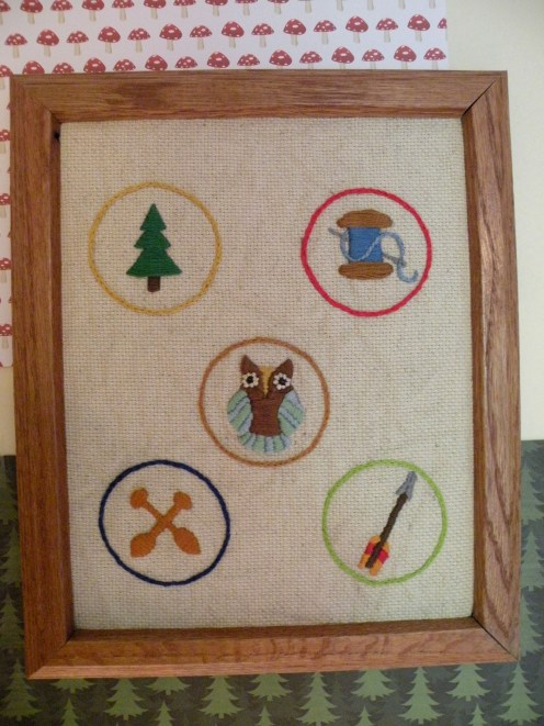 My son's nursery theme was scouts, so I created some custom, embroidered merit badge designs for the wall