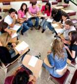 college students sitting in a circle representing TAs teaching classes