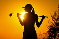 woman golfer in sunset