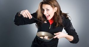 Woman eating eggs