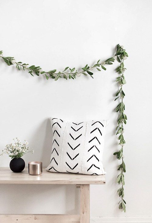 Simple DIY holiday decor ideas using white lights: greenery + lights