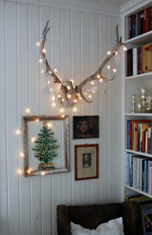 Simple DIY holiday decor ideas using white lights: Antlers + ornaments + lights