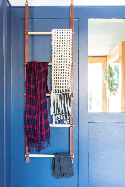 Learn how to make this versatile hanging wood and leather storage ladder. Use it for storing scarves, blankets, towels, or fabric.