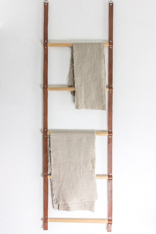 Follow these instructions to make this versatile hanging wood and leather storage ladder. Use it for storing scarves, blankets, towels, or fabric.