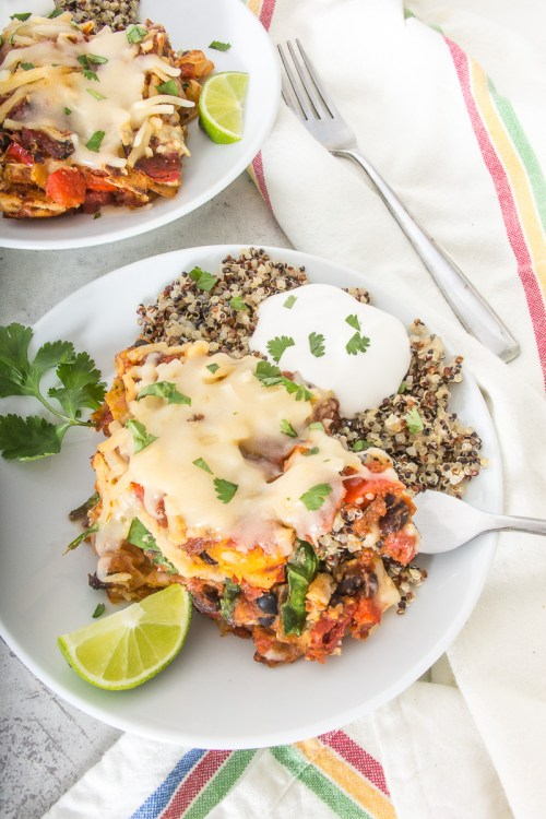 This black bean, squash, and spinach enchilada casserole is vegan and gluten-free, but full of flavorful veggies