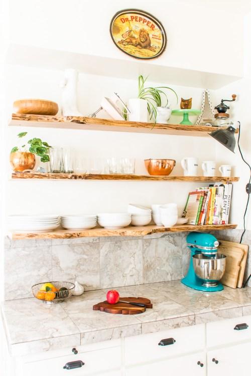 Floating live-edge kitchen open shelves