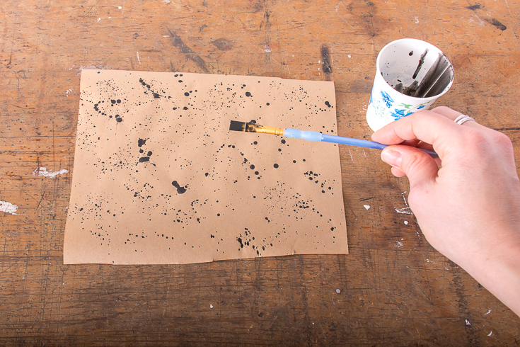 Add personality to your holiday gift wrapping with this easy splatter-paint wrapping paper. #DIY