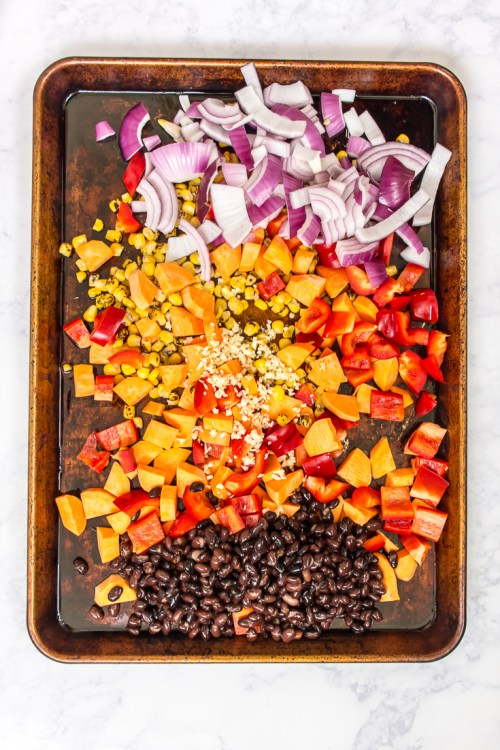 This sheet pan meal of sweet potato and black bean hash can be dinner on its own, but you can also use it to make a variety of other vegan meals.