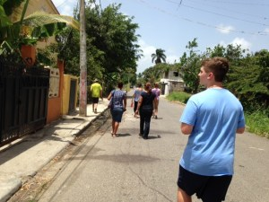 Our group walks down the street in Santiago to invite people to attend VBS.