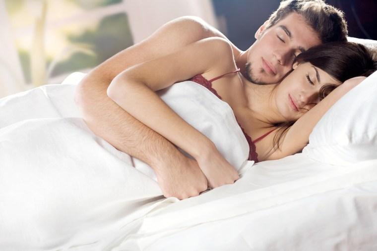 bigstockphoto_couple_sleeping_and_hugging_on_1499251
