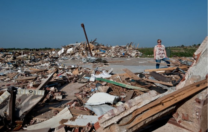 "Wednesday June 26th, 2013 Moore Oklahoma: Abby Larsen stands among the debris left behind after the May 20th, 2013 EF5 tornado destroyed her business, ""A Step Above Learning Center"". When the tornado hit, 23 people, 10 adults and 13 children including a 7 week-old huddled in a 5×7 foot bathroom. Holding onto each other, and with mats over their heads, the roof was blown off and everyone survived, though a few had minor injuries. Several of the children's shoes had been swept off their feet. When they emerged from the bathroom, a race horse from a nearby farm was standing next to them. Save the children has provided about 6-9,000 in toys, furniture, food and reimbursement to help the center re-open. The center in currently in a new location at a local church. -Photo & story from Save The Children"