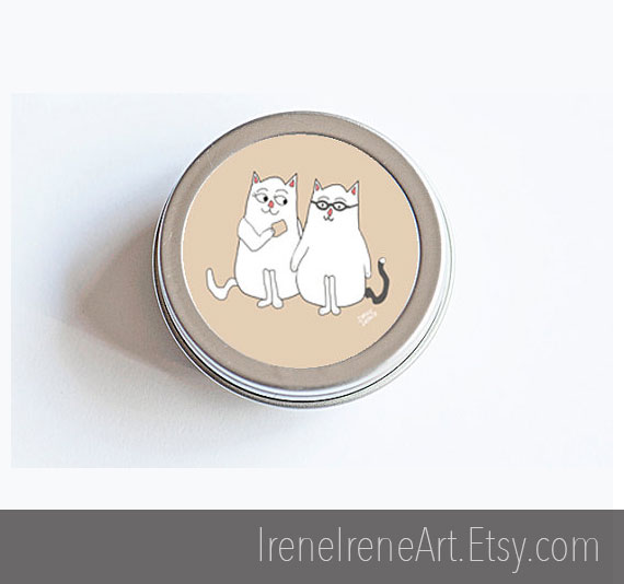 Tin of cat stickers.