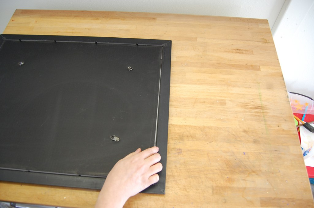 T02 - Lift the backing and glass from the frame