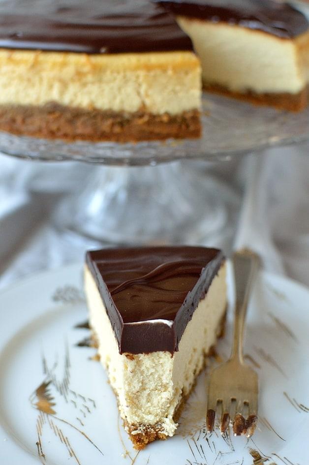 Baileys Irish Cream baked cheesecake with gingersnap crust and Baileys chocolate ganache