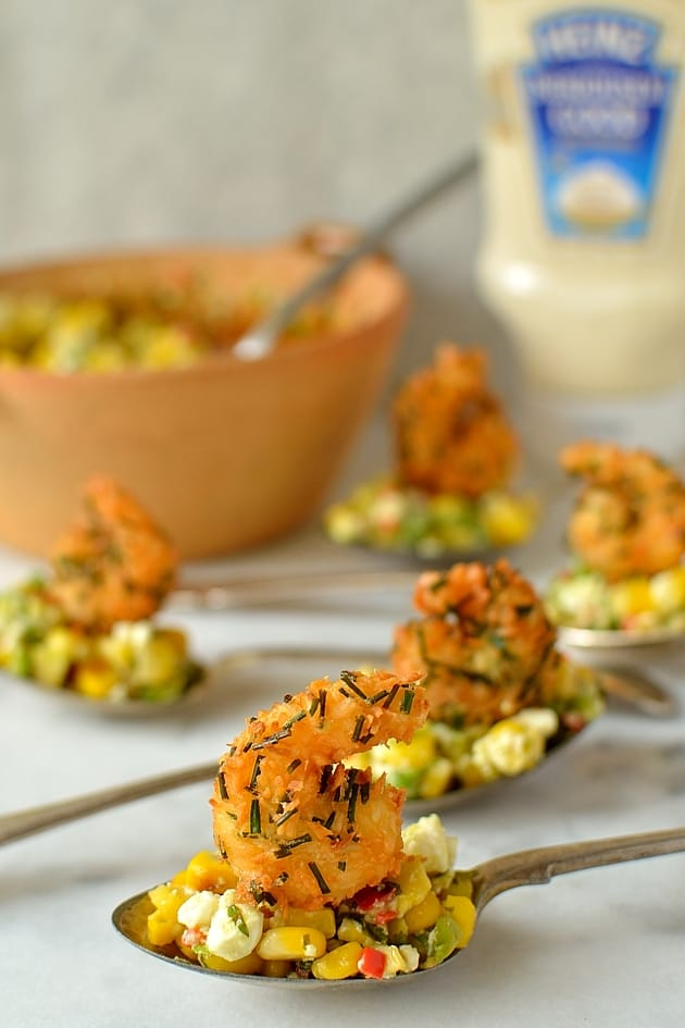 Crispy fried coconut king prawn and sweetcorn, avocado and feta salsa canapes