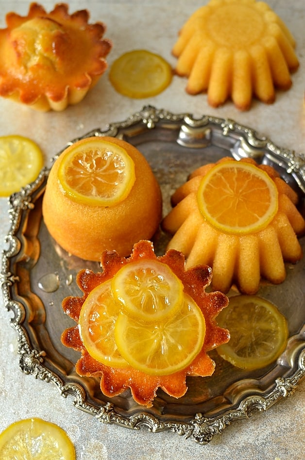 Mini syrupy lemon, olive oil and semolina cakes with candied lemon slices