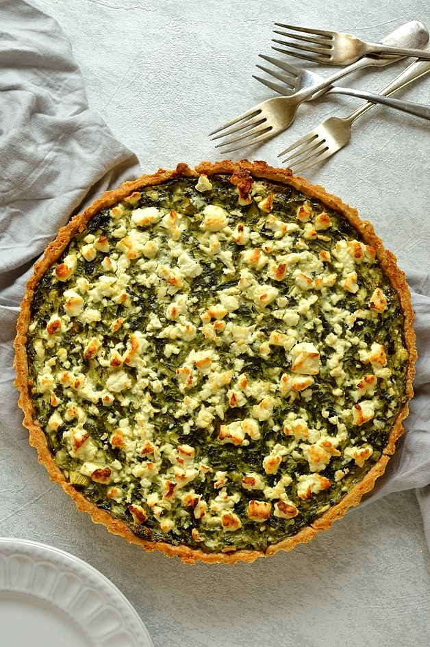 Spanakopita quiche - spinach, ricotta and feta cheese quiche with parmesan pastry