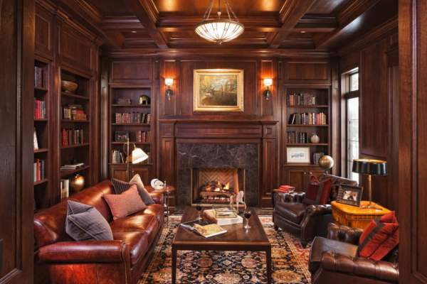 Fascinating-library-bookshelves-for-home-with-classic-design-ideas-with-red-sofa-combine-with-gray-pillow-also-wooden-coffee-table-and-two-brown-armchair-also-black-table-lamp-and-fireplac