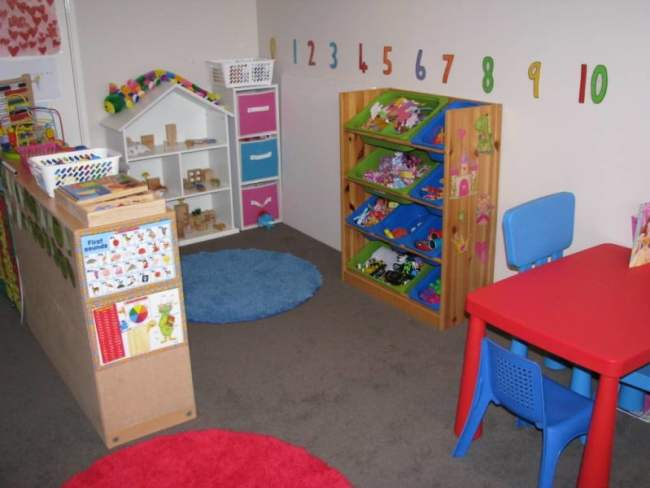 kids-rooms-awesome-white-kids-playroom-design-inspiration-with-red-square-kids-table-and-blue-kids-chairs-also-wooden-toys-storage-best-22-cheerful-kids-playroom-design-ideas