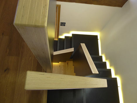 Squared Spiral Winding Modern Staircase Floats On Light