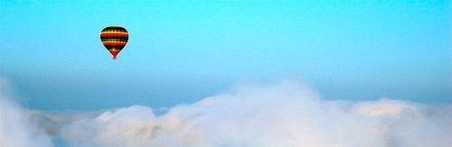 Hot air balloon above clouds