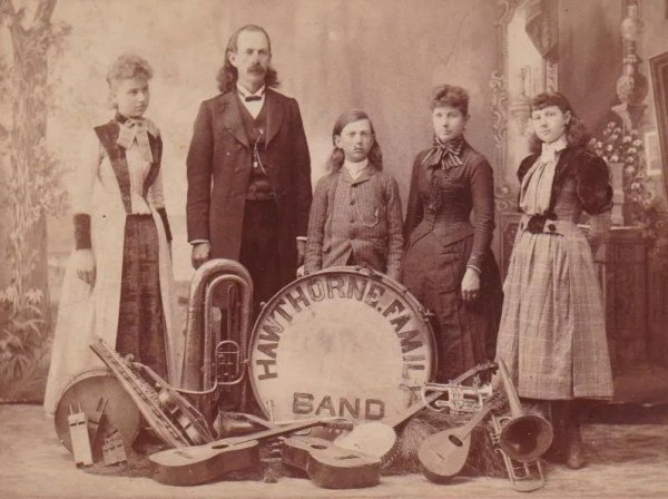 Family band with banjo, guitars, mandolin, drums, horns, and other instruments