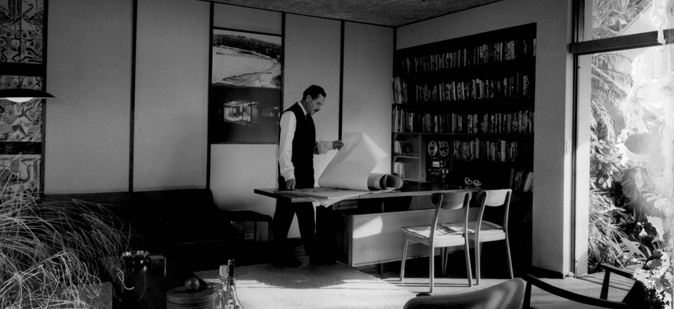 Douglas Snelling inspects plans in his home office, Sydney. Photo Max Dupain (circa 1964).