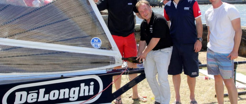 gregg-lawrance-of-delonghi-pours-the-traditional-champagne-over-the-new-skiff-in-the-double-bay-rigging-area
