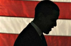 Obama-against-flag-silouette