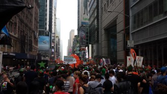 the crowd of marchers fills the street approaching Times Square