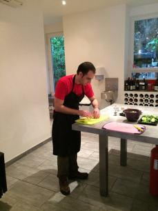 Ian chops things for a salad in our cooking class in Nice.