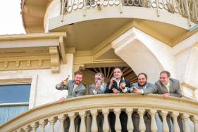 Groom and his groomsmen having a cold one.