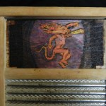 Detail: Will's washboard. Wood burn with colored pencils taken from the Fireball Cinnamon Whisky logo.