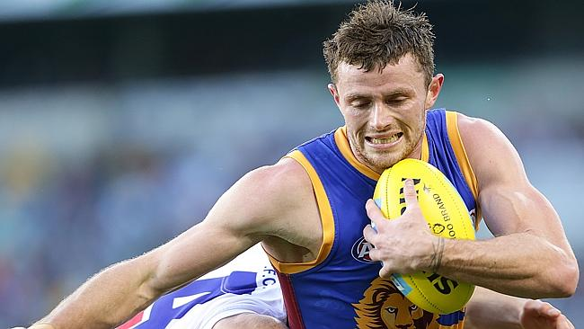 Pearce Hanley slips out of a tackle. Brisbane Lions v Western Bulldogs at The Gabba. Pic Jono Searle.