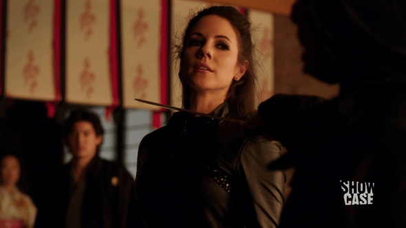 Bo with blade to her throat in Big in Japan
