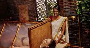 Woman having Ayurvedic sauna with steam treatment.