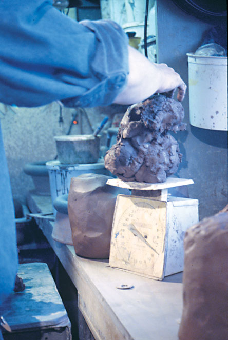 Fig. 2: The clay is weighed to meet exact weight specifications for each drum.