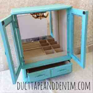 Turquoise painted jewelry cabinet | DuctTapeAndDenim.com