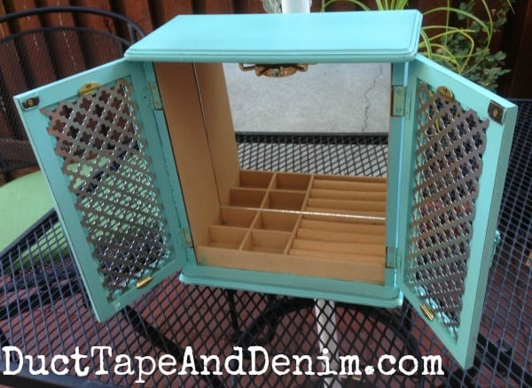 Finished turquoise homemade chalk paint jewelry cabinet found at thrift store. DuctTapeAndDenim.com