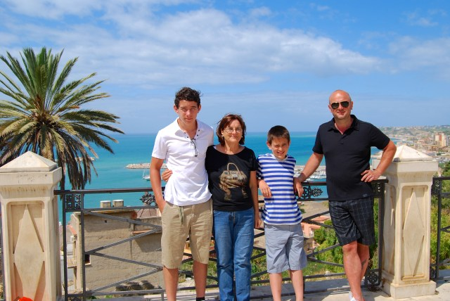 Sean, Nonna Maria, Luca and Stefano pose for a photo in Sciacca's main piazza.