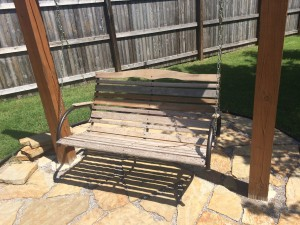 Restain swing garden bench