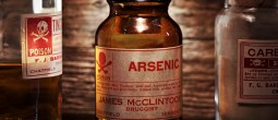 Vintage arsenic poison bottle on antique shelf