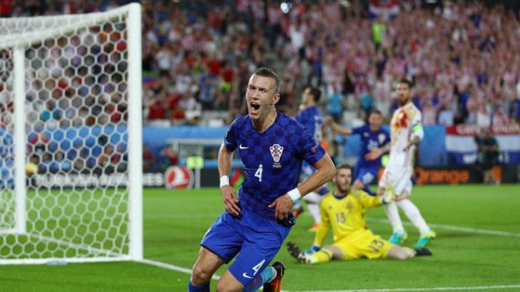 Ivan Perisic wheels away in celebration after scoring the winner against Spain