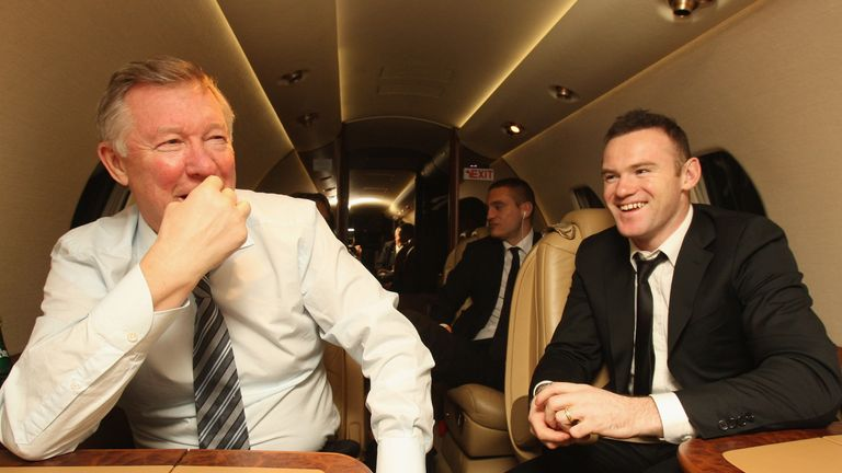 Ferguson and Rooney enjoy the flight home after the FIFA Ballon d'Or Gala in 2011