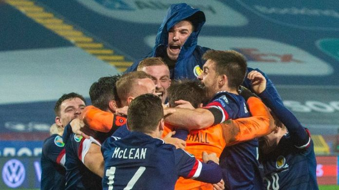 Scotland players celebrate after David Marshall's save secures victory in the penalty shoot out during the UEFA Euro 2020 Qualifier between Serbia and Scotland in Belgrade.