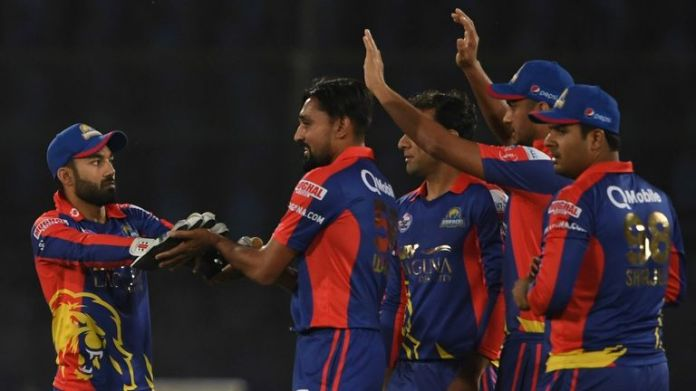 Karachi Kings' Waqas Maqsood (C) celebrates the wicket of Quetta Gladiators' Ahmad Shahzad