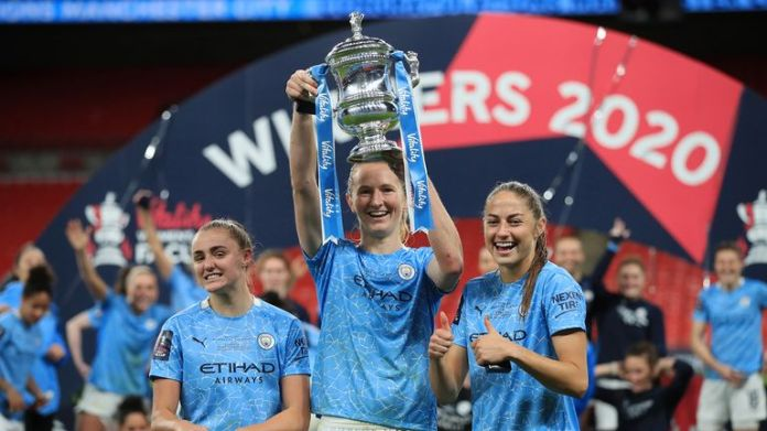 Georgia Stanway, Sam Mewis and Janine Beckie of Manchester City celebrate with the Vitality Women's FA Cup Trophy following their team's victory in the Vitality Women's FA Cup Final match between Everton Women and Manchester City Women at Wembley Stadium on November 01, 2020 in London, England.